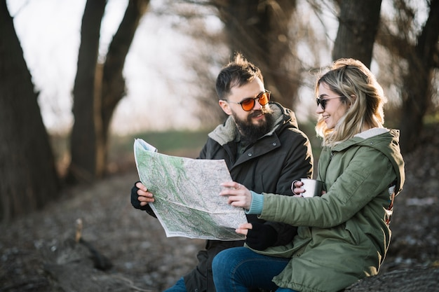 Medium shot couple holding map