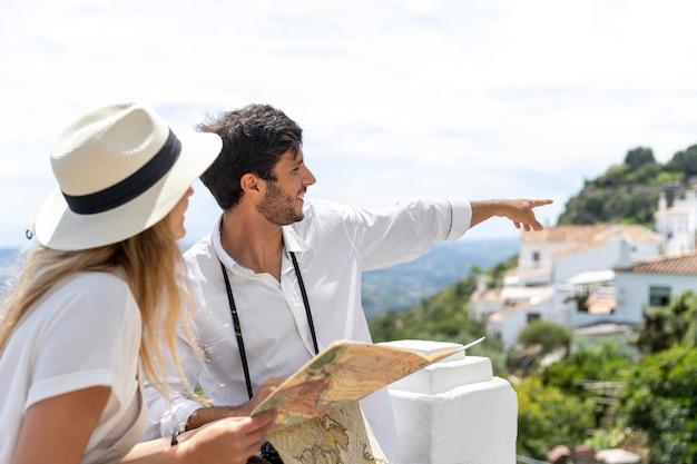 Medium shot couple holding map
