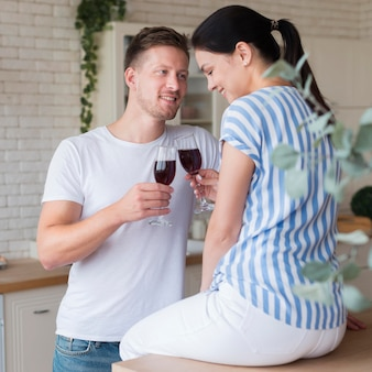 Medium shot couple holding wine glasses