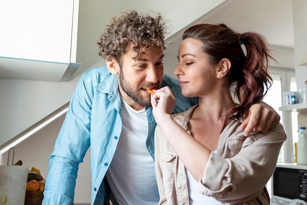 Medium shot of couple in kitchen