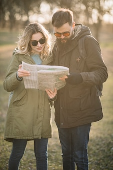Medium shot couple looking at map