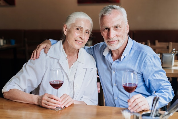 Medium shot couple posing at restaurant