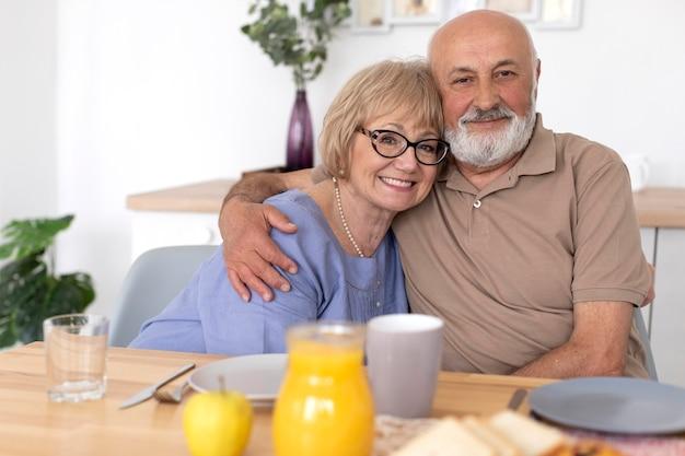 Medium shot couple sitting at table