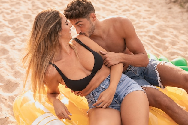 Medium shot of couple spending time together at beach