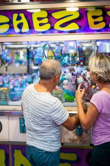 Medium shot couple at toy stand