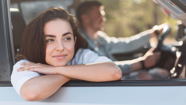 Medium shot couple traveling by car
