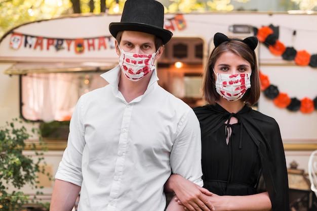 Medium shot couple wearing masks