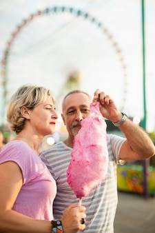 Medium shot couple with pink cotton candy