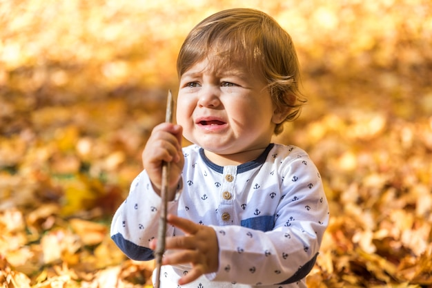 Medium shot crying baby with stick