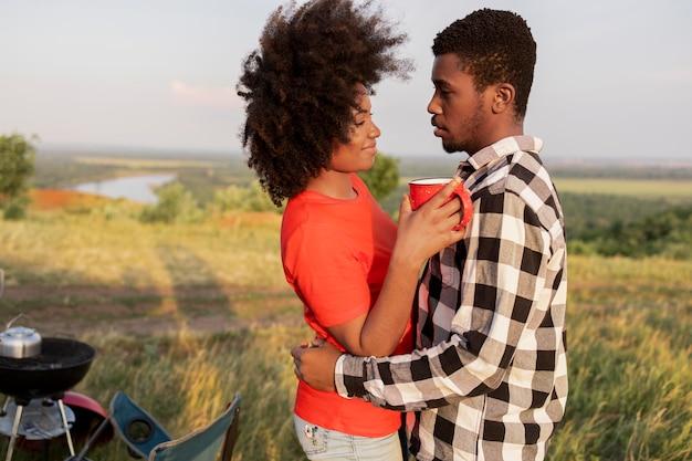 Medium shot cute couple outdoors