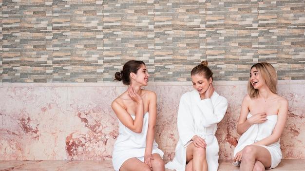 Medium shot cute girls with robes indoors