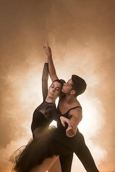 Medium shot dancers couple posture
