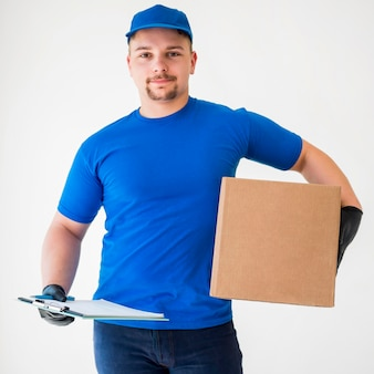 Medium shot delivery man holding box