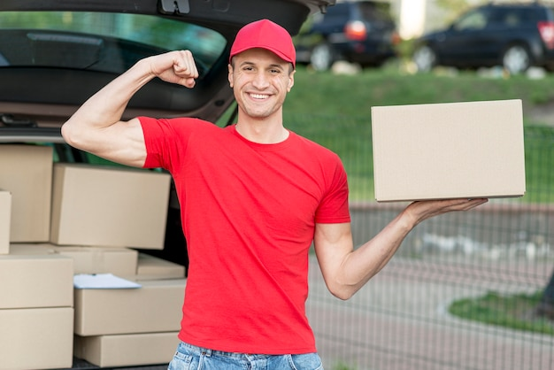 Medium shot delivery man with box