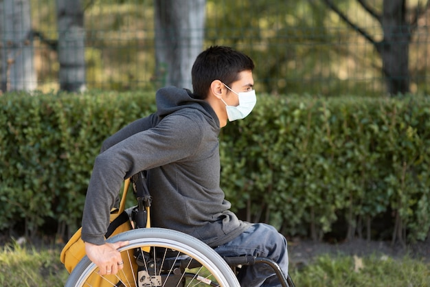 Medium shot disabled man wearing mask