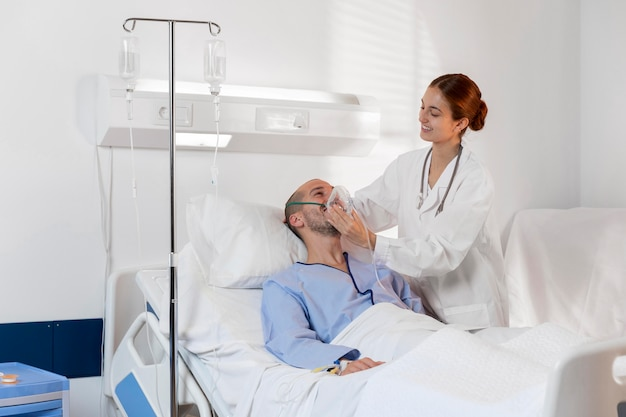 Medium shot doctor holding oxygen mask