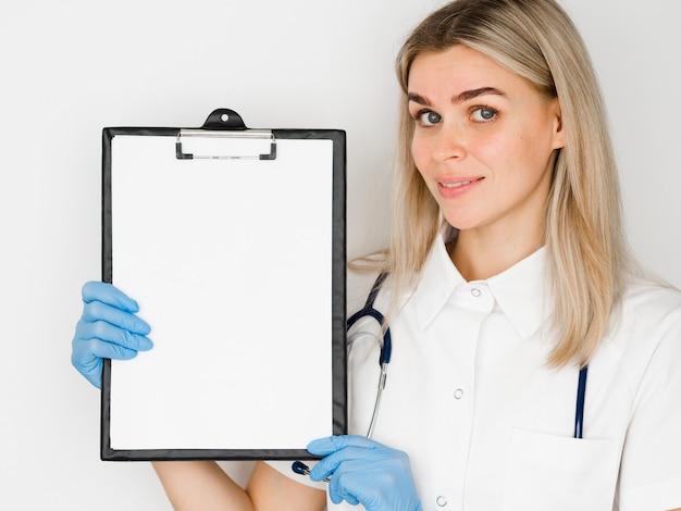 Medium shot doctor with clipboard