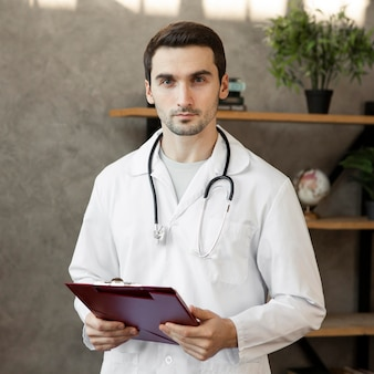Medium shot doctor with stethoscope