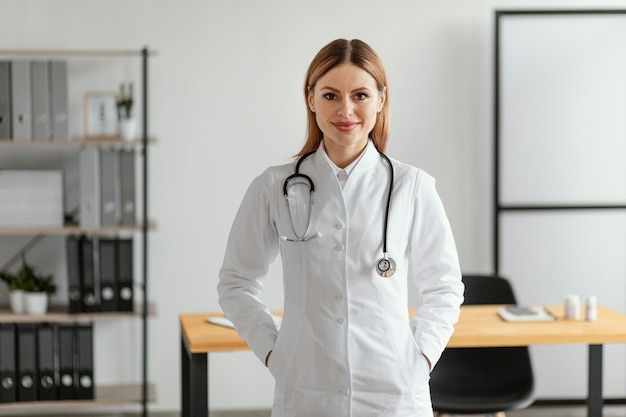 Medium shot doctor with stethoscope Free Photo