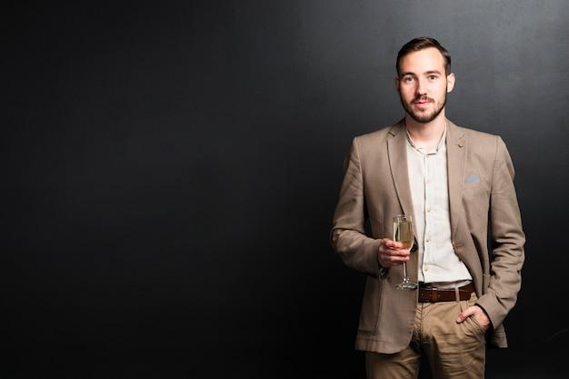 Medium shot of elegant man at new years party