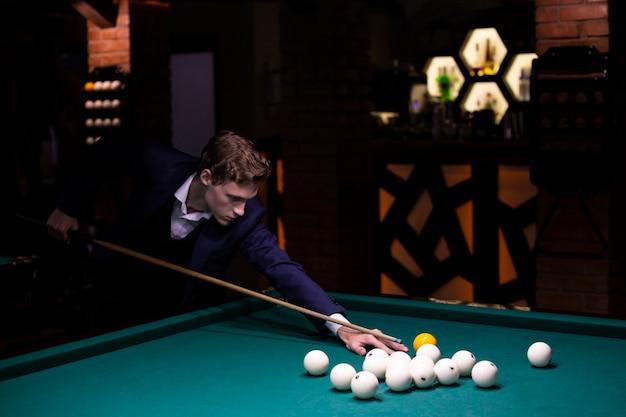 Medium shot elegant man with yellow balls
