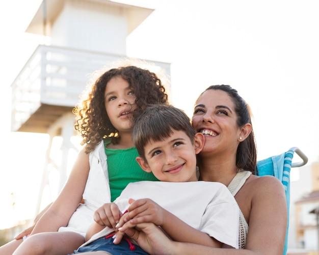 Medium shot family at beach