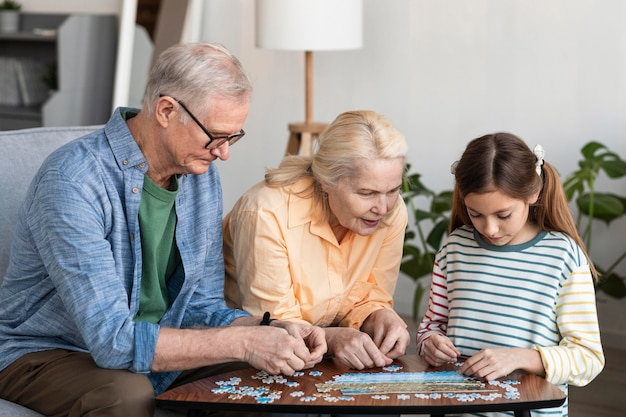 Medium shot family doing puzzle together