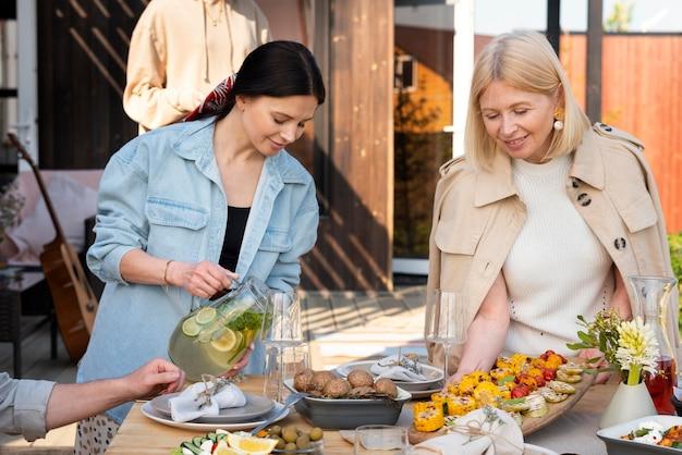 Medium shot family gathering at table