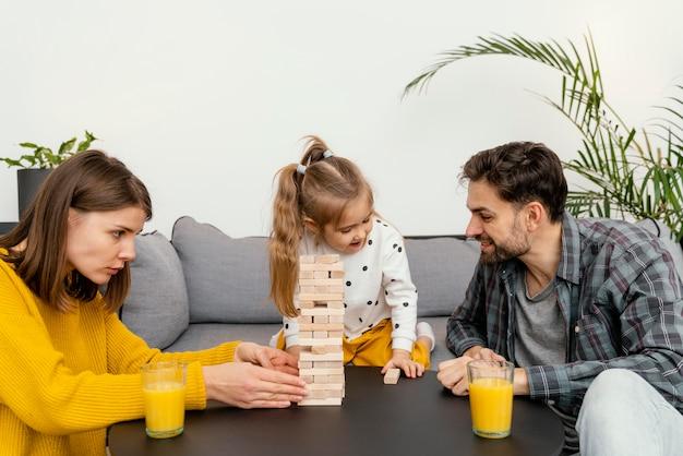 Medium shot family playing game