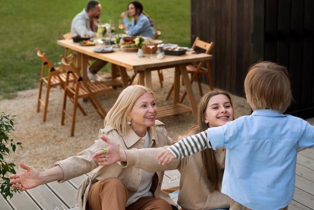 Medium shot family playing with kid