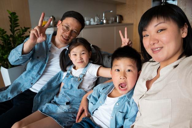 Medium shot family taking selfie