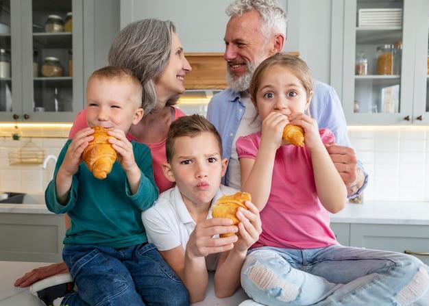 Medium shot family with croissants