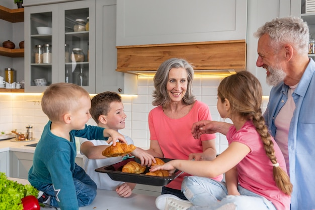 Medium shot family with tasty croissants