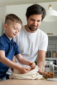 Medium shot father and kid indoors
