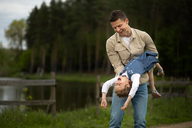 Medium shot father playing with kid