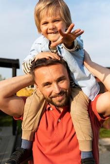 Medium shotfather playing with kid