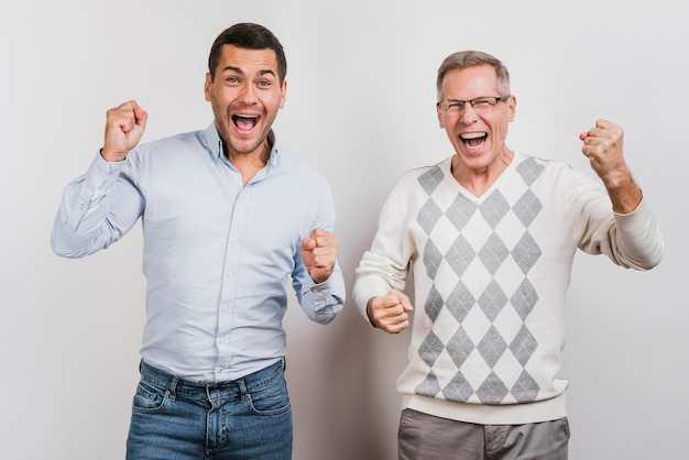 Medium shot of father and son cheering