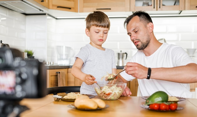 Medium shot father and son in kitchen