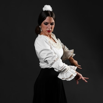 Medium shot of flamenca dancer