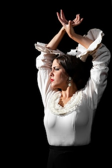 Medium shot of flamenca with hands crossed