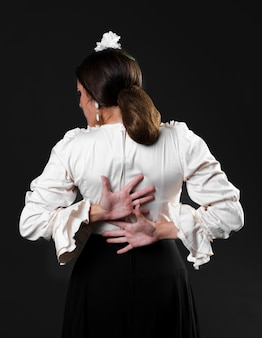 Medium shot flamenco dancer back view