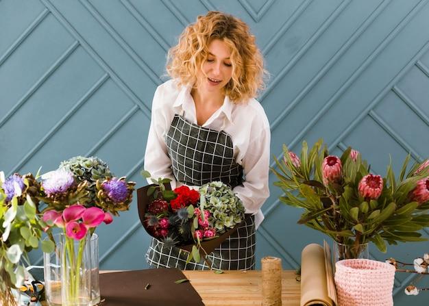 Medium shot florist at flower store