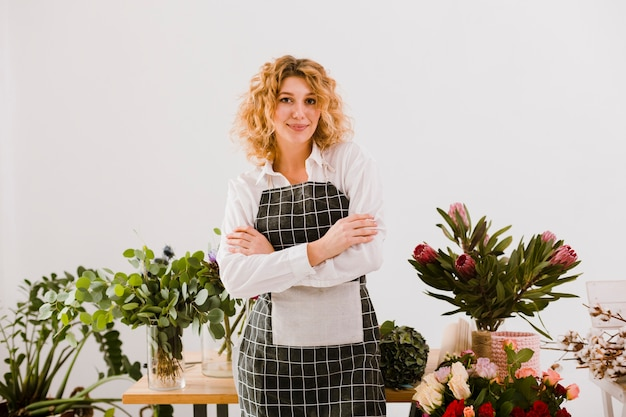 Medium shot florist posing with arms crossed
