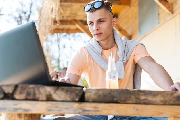 Medium shot freelancer sitting at table