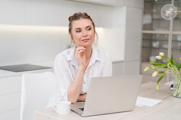 Medium shot freelancer with laptop