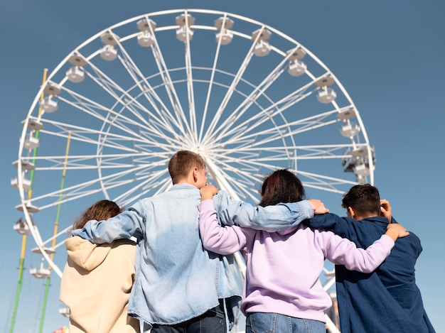 Medium shot friends at amusement park