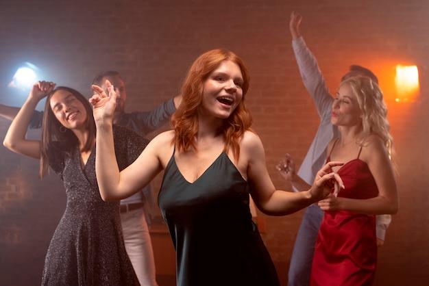 Medium shot friends dancing at club