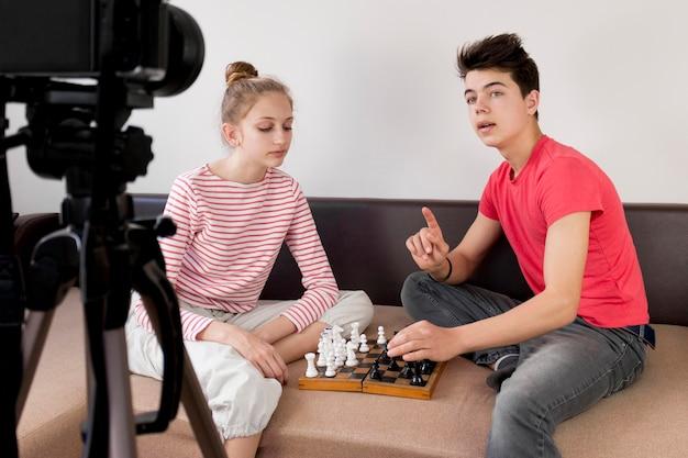 Medium shot friends playing chess
