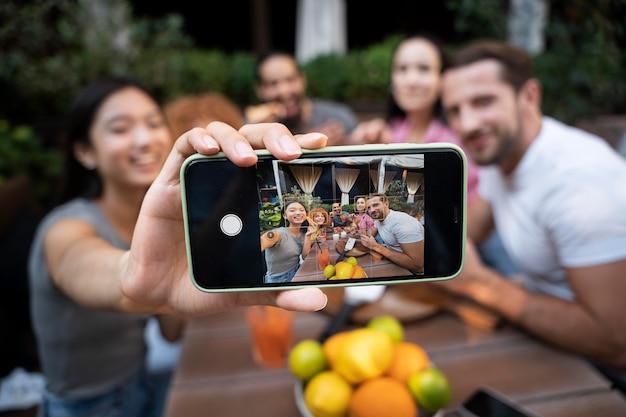 Medium shot friends taking photo