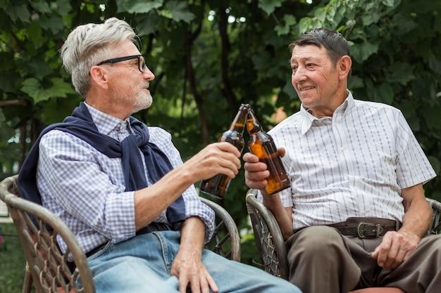 Medium shot friends toasting outdoors